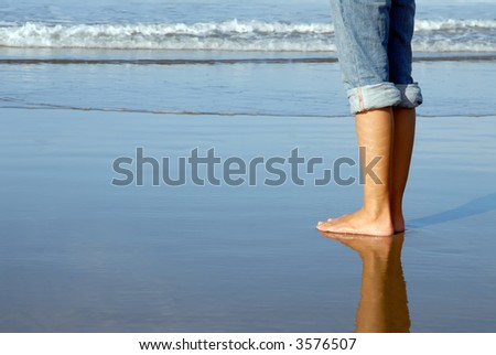 Feet of a girl watching the ocean