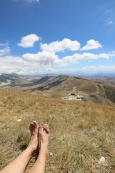 feet of a hiker while resting after the long walk in the Apennine mountains in central Italy in summer