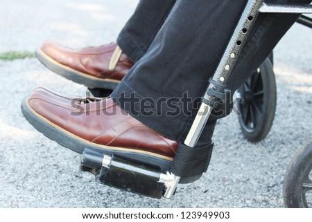Feet of a person in a wheelchair