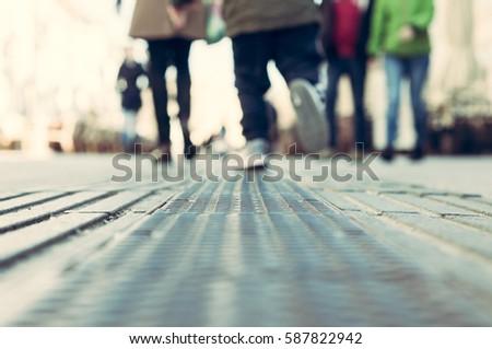 feet of a running child blurred ...