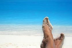feet of a woman on a tropical beach