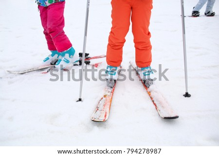feet of children in ski equipment in the snow #794278987
