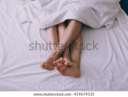 Feet of couple side by side in bed  #459674533