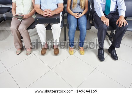 Feet of different people sitting in a waiting room #149644169