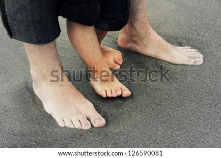 Feet of Father and Son/Not Alone