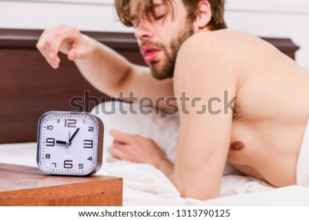 Feet of man sleeping in comfortable bed. Picture showing young man stretching in bed. This is wonderful morning