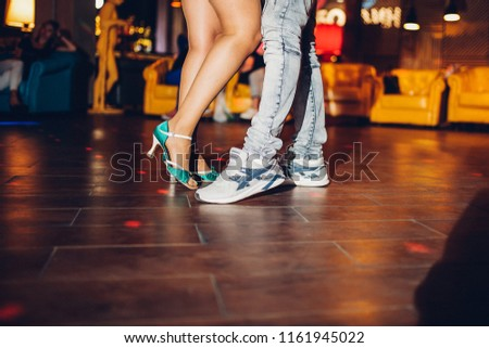 feet of people dancing in the club, a big party with incendiary music, gay dances, rehearsal of professional dance in courses for teaching rumba, ballroom dances or sports disciplines  #1161945022