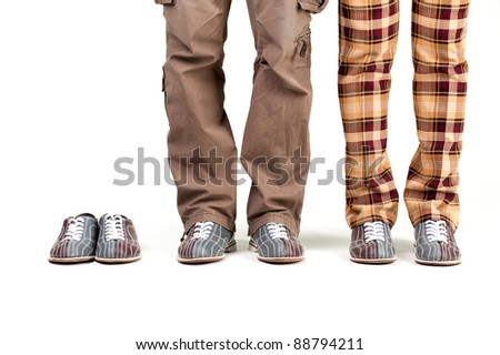 feet of players in the shoes of bowling on a white background. add