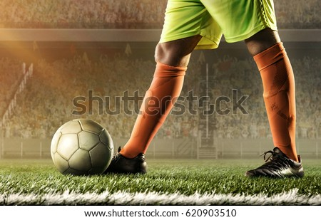 feet of soccer player with a ball #620903510