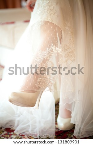 feet of the bride in shoes, wedding details - stock photo