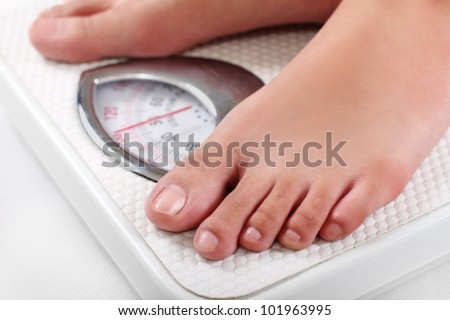 Feet on a weighing scale.Close up.
