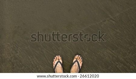 Feet on black sand #26612020