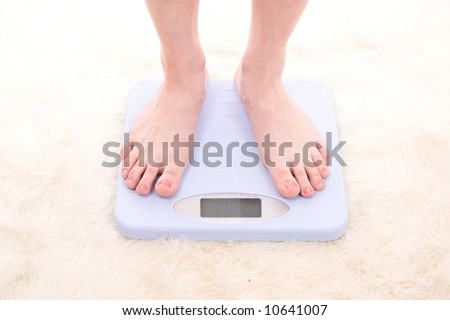 Feet on digital scales - stock photo
