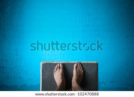 feet on diving board - stock photo
