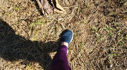 Feet on the dry grass in the wild
