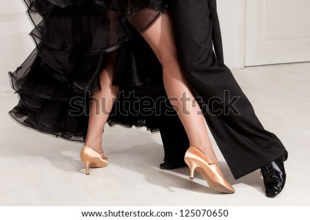 feet partners on the dance floor - stock photo