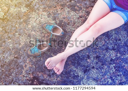 feet resting traveler without shoes, toned #1177294594