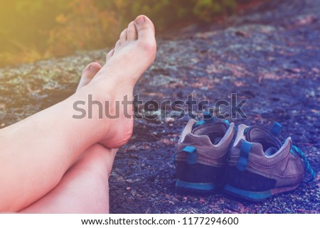 feet resting traveler without shoes, toned #1177294600
