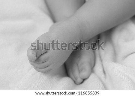 Feet's of a baby in black and white