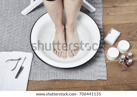 Feet soak before pedicure in water #706441135