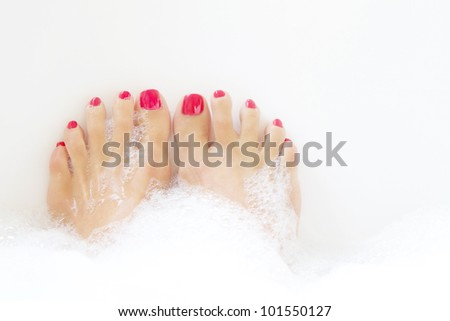 Feet soaking in spa bath with space for text