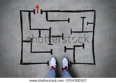 Feet standing in the beginning of a black drawn sketch on a concrete floor background, pathway and pathfinding concept Stock photo ©