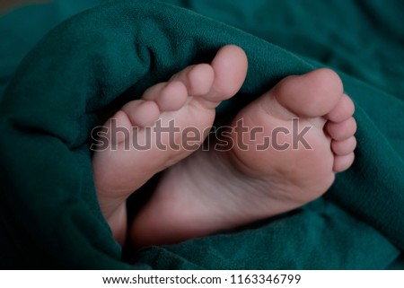 Feet sticking out of blanket comforter sleeping  #1163346799
