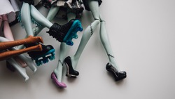 feet toy dolls close-up. Modern toy doll shallow focus