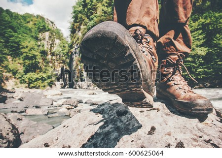 Feet trekking boots hiking Traveler alone outdoor wild nature Lifestyle Travel extreme survival concept summer adventure vacations steps sole view from below