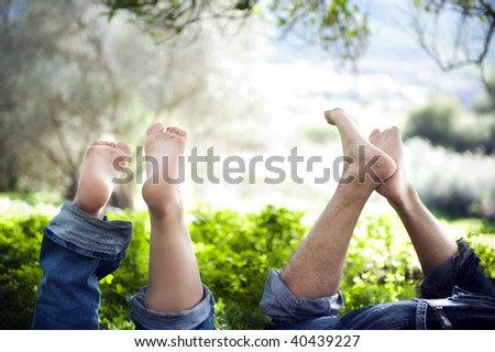 Feet up of a young  couple in love expressing relaxation and fun