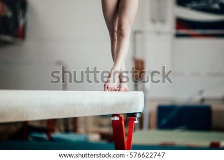 feet young girl athlete gymnast on balance beam #576622747