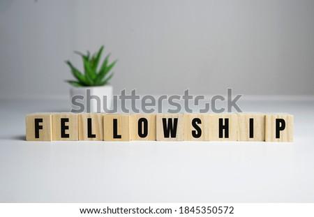 Fellowship concept - Fellowship word on wooden cubes