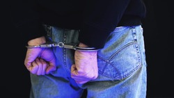 Felon in handcuffs with police strobe flashes