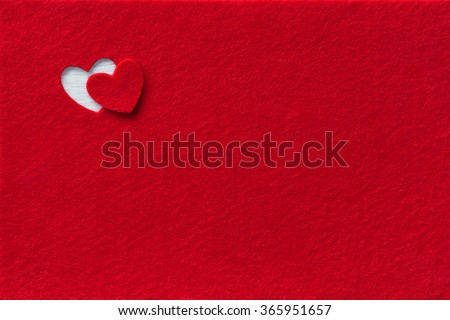 Felt Background for design to Valentine's Day. Decorative heart from red felt. View from above. Valentines Day concept