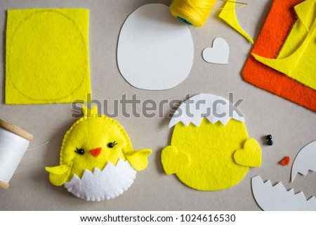 Felt chicken, felt sheets, template, threads on the table.  Creating Easter chicken from felt. Felt craft used in kids handicraft. Top view
