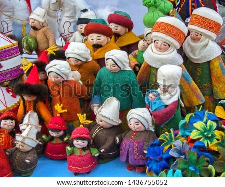 Felt dolls of Kazakh people (men, women, children) in simple national costumes. Dropped eyes. Kimeshek - traditional headgear of married woman.