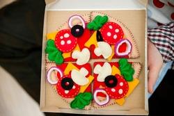 Felt pizza. Felt food toys for the kids. Preschool game for young children. Montessori education