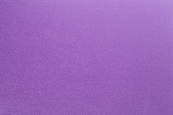 Felt surface in deep dark purple color. Abstract background and texture for design.