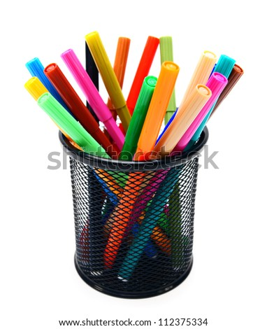 Felt-tip pens in a basket.