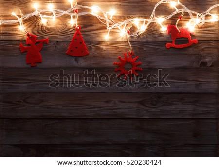 Felt toys on wooden background