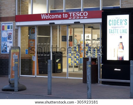 Feltham, London, Middlesex, England - August 04, 2015: Tesco supermarket main entrance to store, company founded by Jack Cohen in 1919