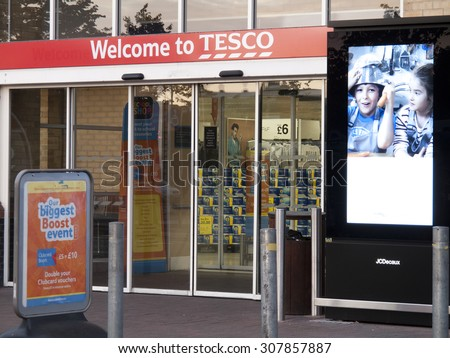 Feltham, London, Middlesex, England - August 19, 2015: Tesco supermarket main entrance to store, company founded by Jack Cohen in 1919