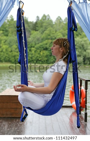 Female Aerial  Relaxing. Yoga in a hammock