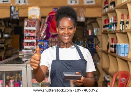 female african store attendant smiling and gives a thumbs up Photo stock ©