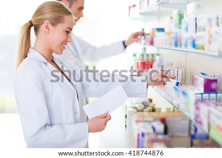 Female and male pharmacists in pharmacy