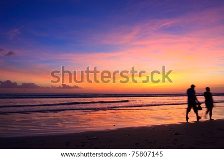 Female and male runners silhouette  with a sunset sky and sea