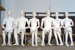 Female and male white plastic mannequins sitting on the ladder