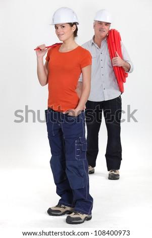 female apprentice and senior plumber