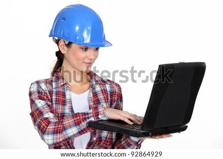 Female architect correcting designs