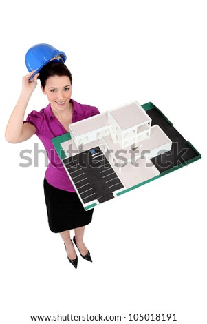 Female architect holding a scale model - stock photo